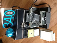 Vintage (Circa 1969) Poloroid Land Camera and Accessories - Mint