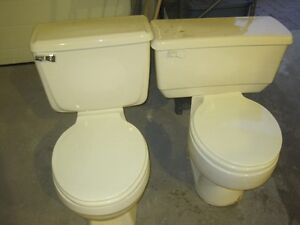 2 american standard toilets for sale
