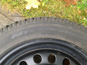 Winter tires on rims. Located in Creston.