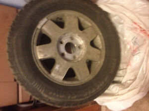 "15"" alloy rims and studded winter tires"