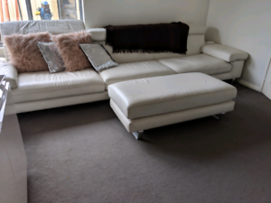 White leather lounge suite with chaise