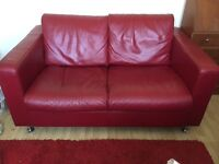 Red leather 2 seater couch