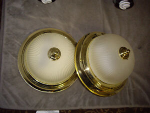Two gold colored ceiling lights