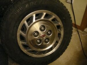 4-185 75 r14 snow tires with over 95% remaining on 5x115mm rims