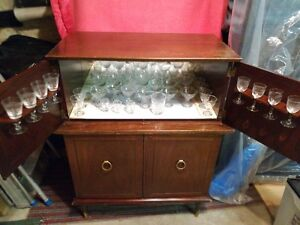 Liquor Display Cabinet with glasses included.