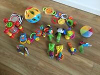Collection of baby rattles and toys