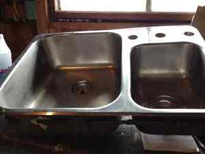 Stainless steel double sink and strainers