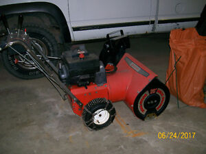 sears snow blower works great < older but reliable
