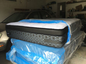 A new Sealy Queen Size Mattress and box.