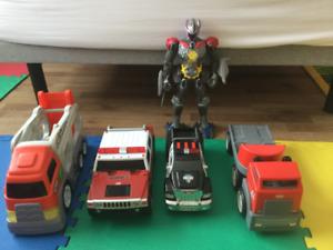 4 big cars an a robot