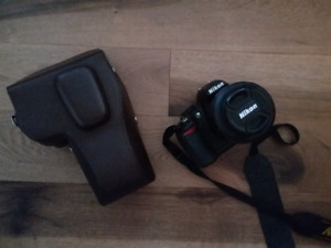 Nikon d3100 with 35mm lens and custom leather case