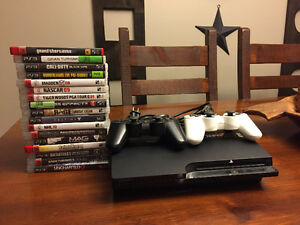 PS3 SYSTEM WITH 17 GAMES AND TWO CONTROLLERS