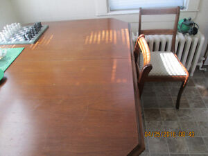antique solid mahogany dinning table and 4 chairs