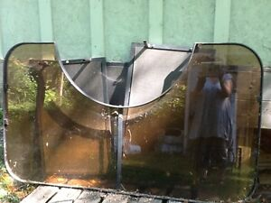 outdoor glass and metal bar and shaded unbrella