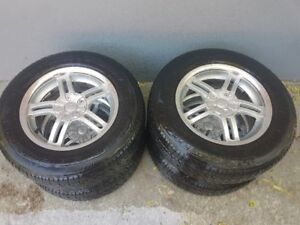 4 tires 215 70 16 4 season very good condition with 4 steel rims