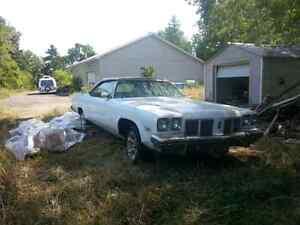 1975 white Oldsmobile convertible