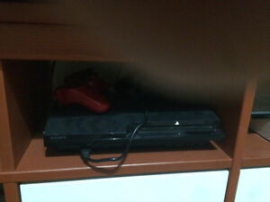 PS3 console with controllers and multiple games