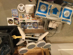 Nintendo Wii with many extra games and attachments