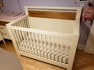 Baby crib white with wood accents
