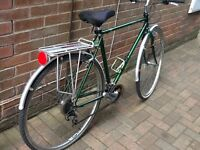 Raleigh hybrid town and country road bike