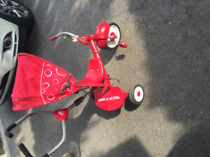 Kids Radio Flyer red trike with push handle