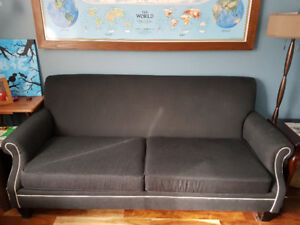 Free for pick-up. Charcoal grey fabric sofa.