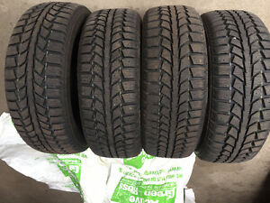 4 Uniroyal Tiger Paw Ice & Snow II Winter Tires Almost Brand NEW Kitchener / Waterloo Kitchener Area image 1