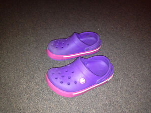 Purple Crocs size 1 and monkey slippers size 1
