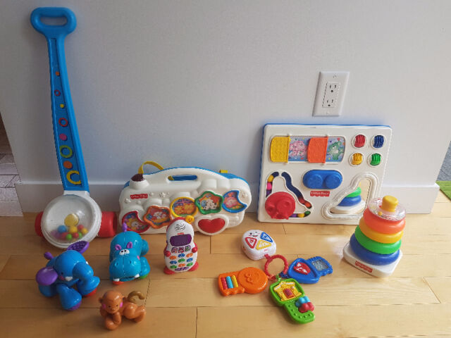 Assortment of Fisher Price Toys
