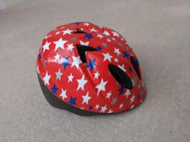 Bike helmet, small red stars, good condition