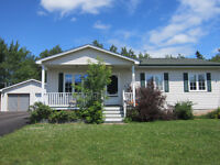 Bungalow with double detached garage and finished basement