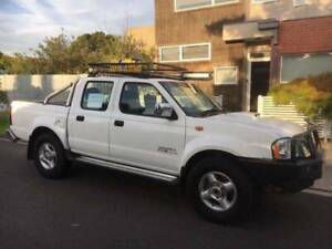 2012 Nissan Navara White. V Good Condition, includes Camping Gear