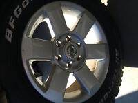 4-LT265/65-18 BFG a/t on Nissan Titan wheels, 50% tread left