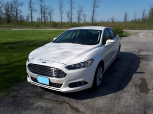 Barely driven 2013 Ford Fusion with Carproof report.