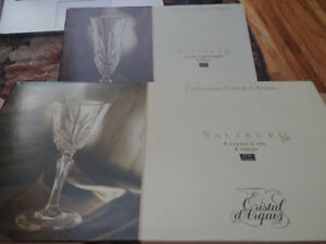 4 Crystal Champagne Flutes, and 4 Crystal Wine Glasses 100$
