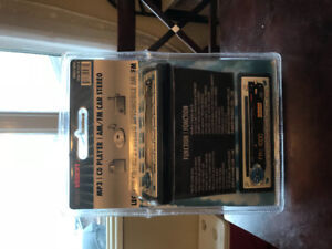 Car stereo deck and front and rear speakers -brand new