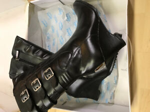 Ladies motorcycle boots. Size 9 brand new in the box.
