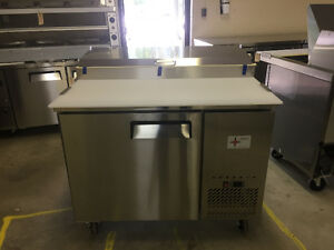 used and new pizza and salad prep tables
