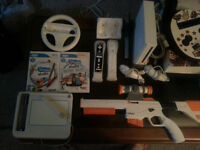 WII+2 manettes+Wii fit+guitar hero+fusils+draw studio+38 Jeux