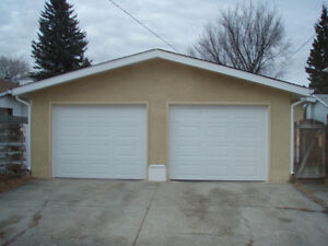OVERSIZED DOUBLE GARAGE WITH NEWER DOORS AND WINDOWS!