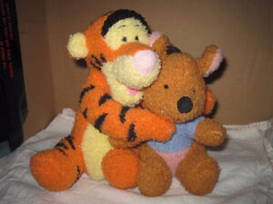 Plush Tigger and Winnie the Pooh Hugging the Best of Friends