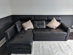 Real leather couch with storage and turns in queen size bed