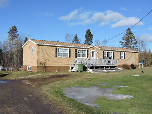 Nice mini home on a full basement with 10 ACRES!