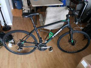 Trek dual sport 2 hybrid bike and thule locking bike rack