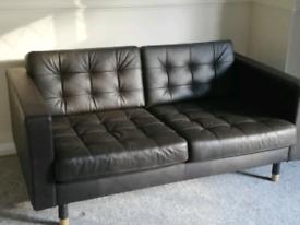 Black two-seater sofa, black leather