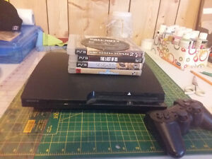 Playstation 3 with one controlder and 5 games