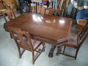 Antique, solid wood dining table and chairs