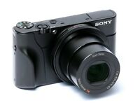 Sony rx100 compact digital camera. With aluminum case, 32GB high speed case and fitted camera grip