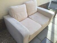 2 seater cream fabric sofa
