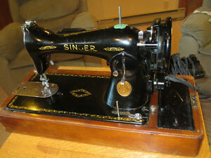 Old singer sewing machine with case & attachments.